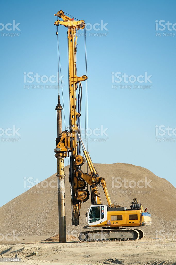 Machine Digging Foundational Pillars royalty-free stock photo