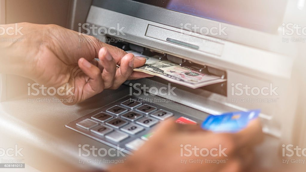 ATM machine, dollars and credit card stock photo