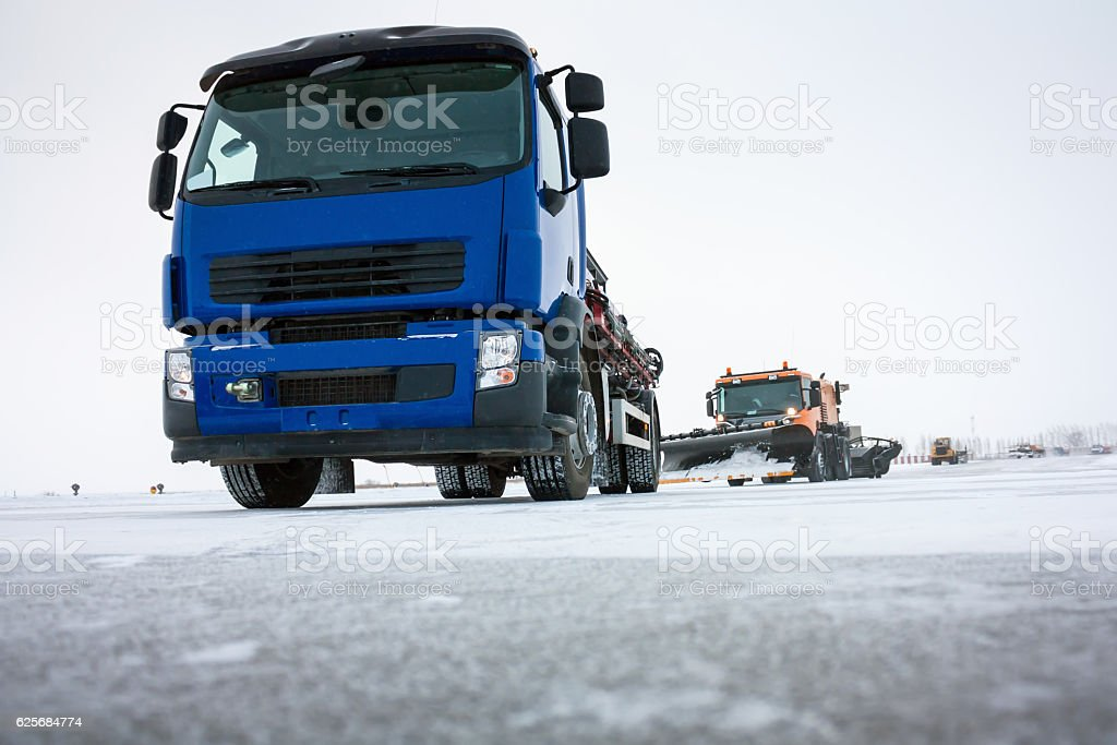 Machine for distribution of liquid anti-icing reagents on runway royalty-free stock photo