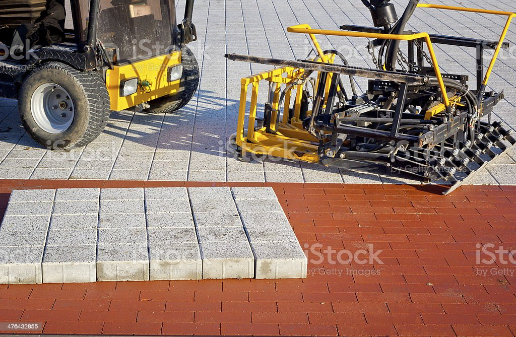 Machine for laying pavement royalty-free stock photo