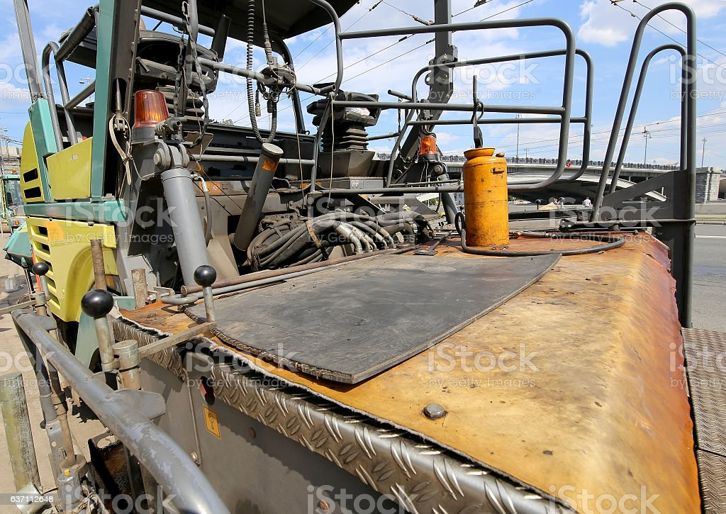 Machine for repair of roads in the modern city (close-up) stock photo