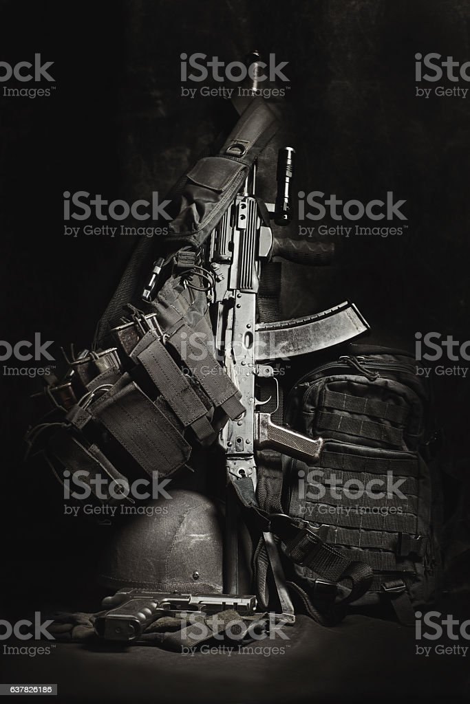 machine gun AK, military helmet and ammunitions stock photo
