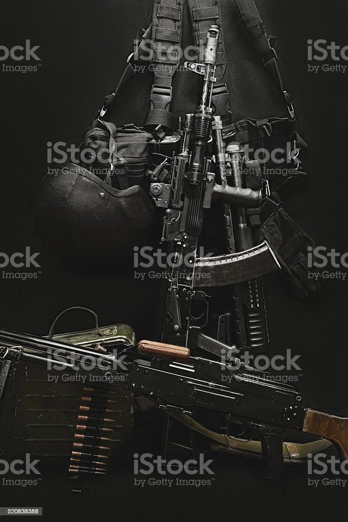 machine gun, AK, rifle, military helmet and ammunitions stock photo
