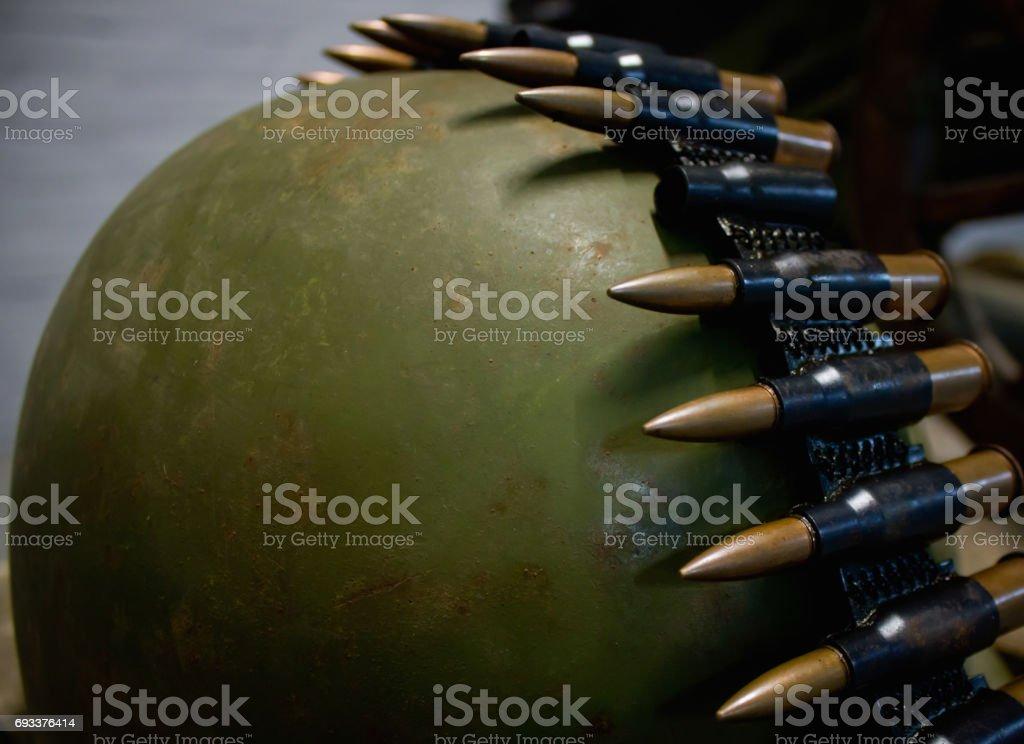 Machine gun belt on the green helmet stock photo