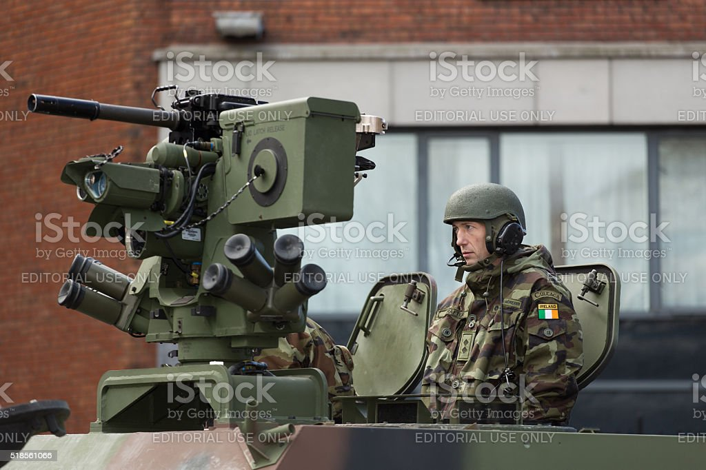 Machine gunner in armored wehicle stock photo