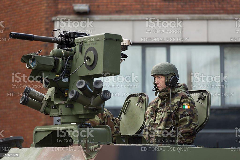 Machine gunner in armored wehicle stock photo