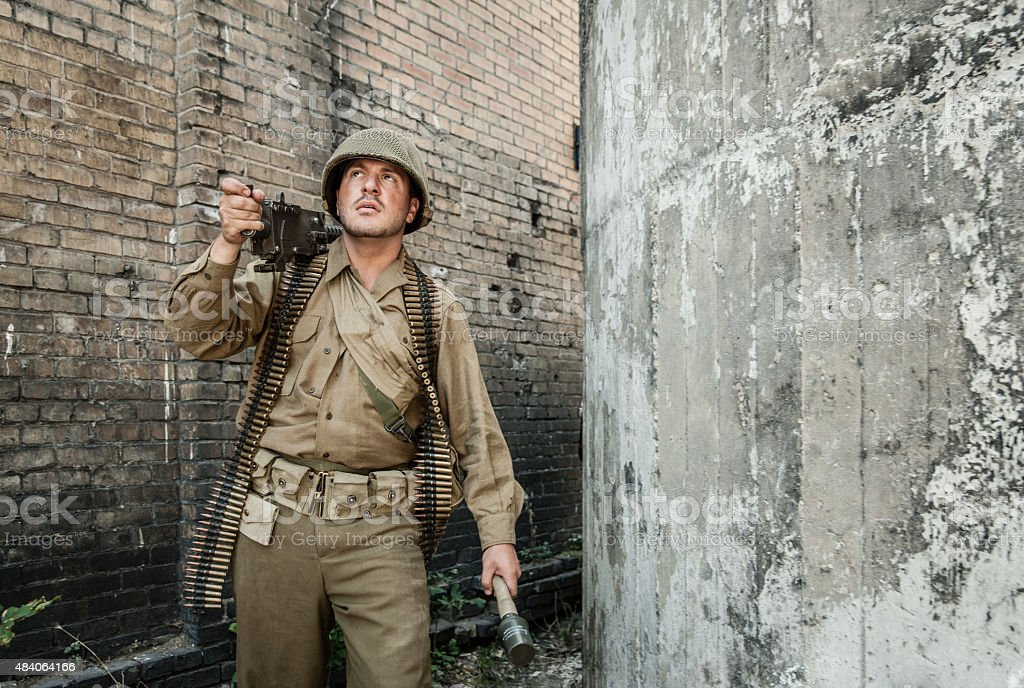 WWII Machine Gunner on Patrol stock photo