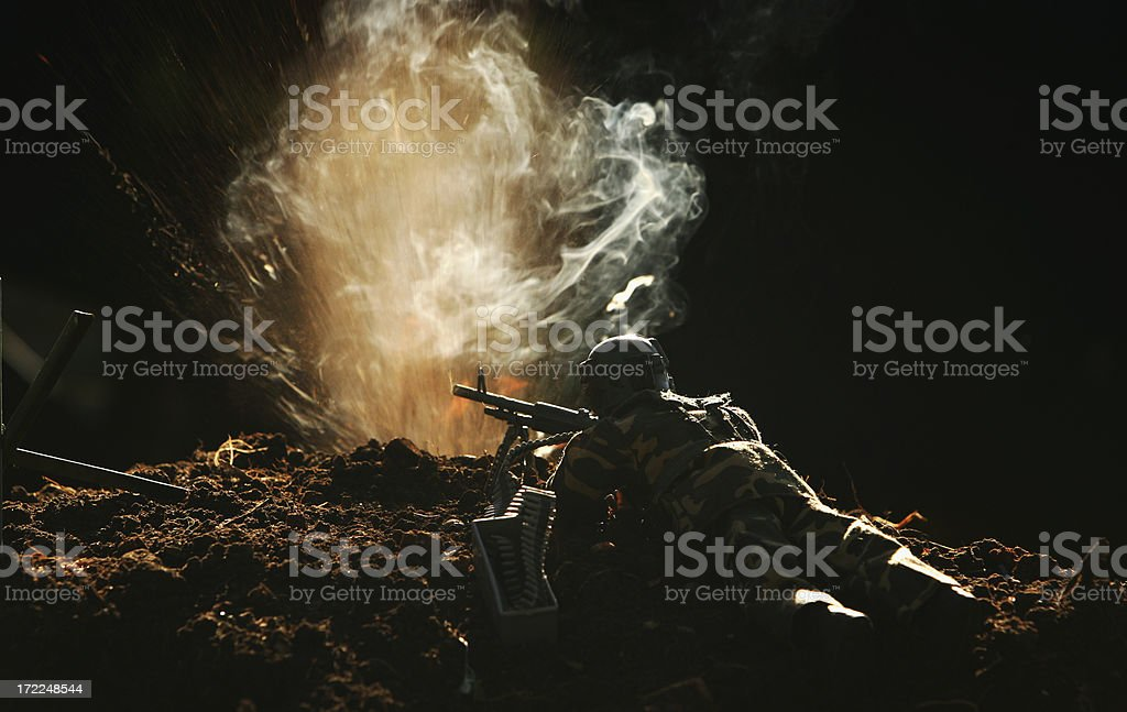 Machine Gunner under fire stock photo