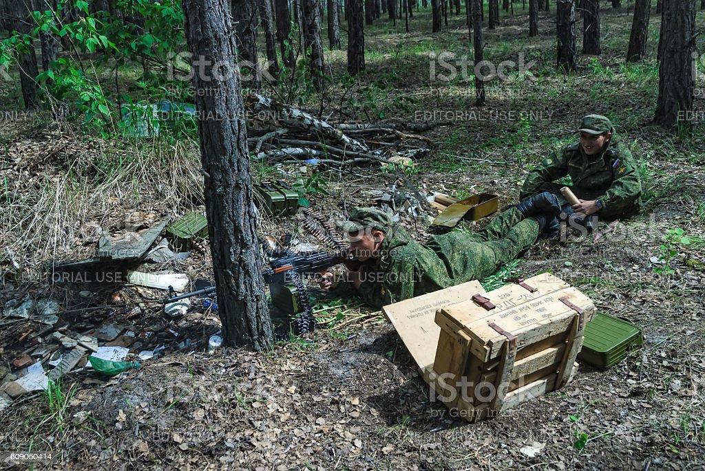 Machine gunners ambush in forest stock photo