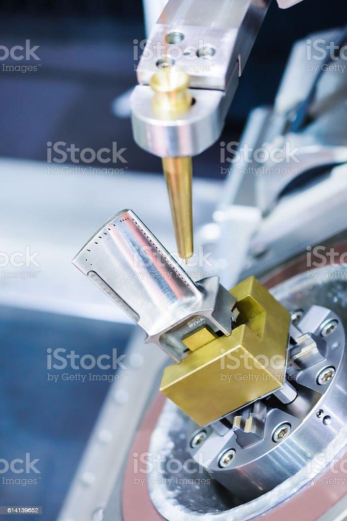 EDM machine handles aircraft engine turbine blade. stock photo