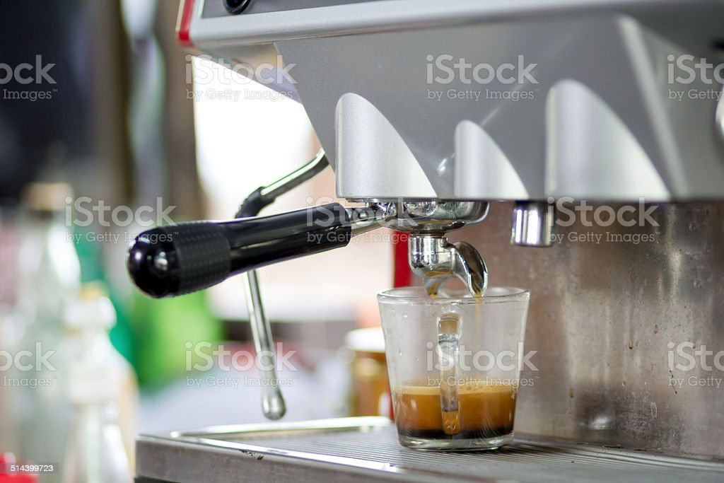 machine making coffee stock photo