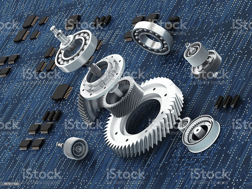 Machine parts on circuit board royalty-free stock photo