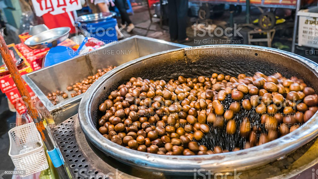 Machine roasting chestnuts in china town (Yaowarat) Road stock photo