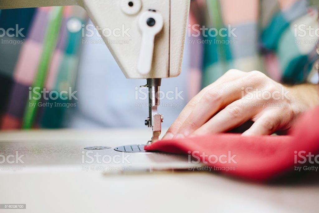 Machine sewing close up stock photo