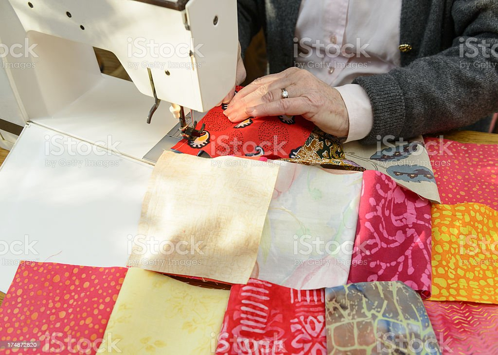 Machine sewing patches for patchwork quilt royalty-free stock photo