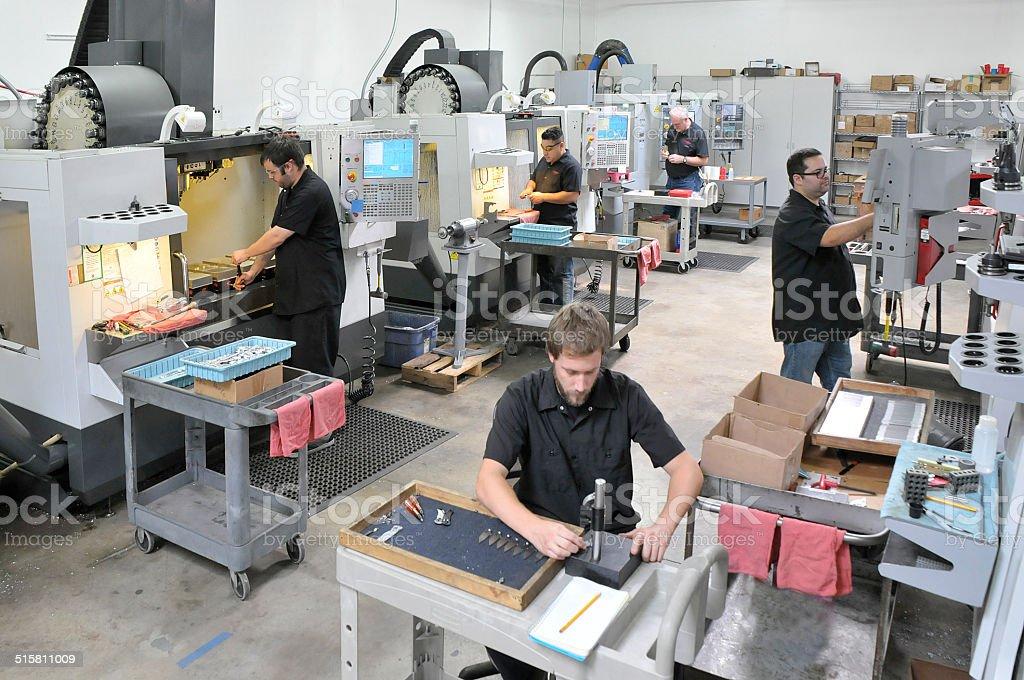Machine Shop with precision cnc equipment and operators stock photo