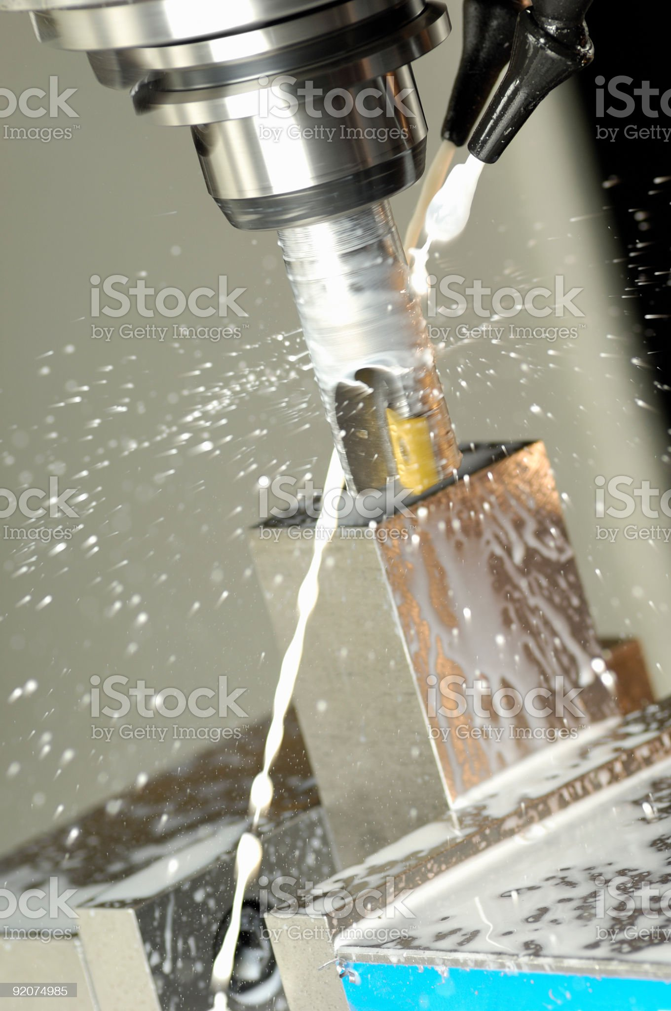 CNC machine tool cutting steel in a machine shop. royalty-free stock photo