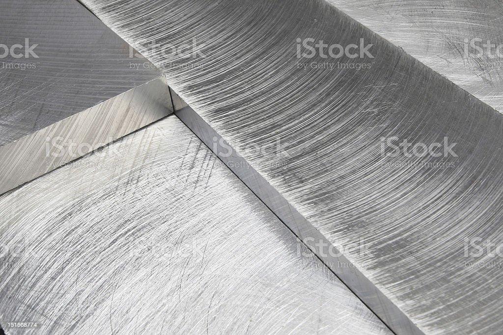 Machined metal blocks at an angle stock photo