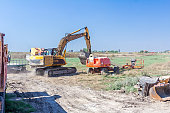 Machinery are parked at construction site