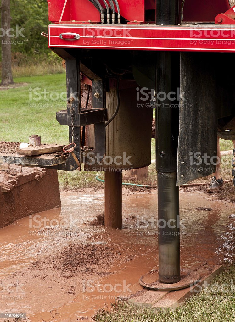 Machinery drilling well in yard stock photo