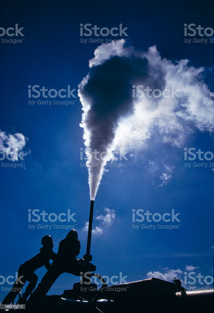 A machinery for Geothermal power emitting tons of smoke stock photo