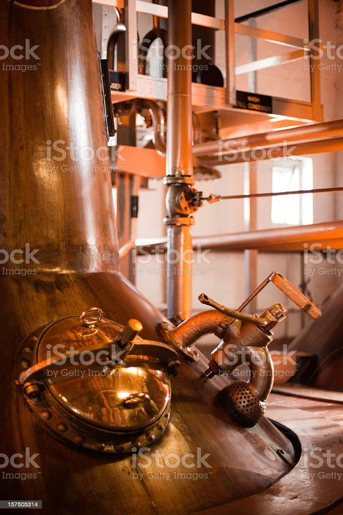 Machines operating a whiskey distillery in Islay, Scotland  stock photo