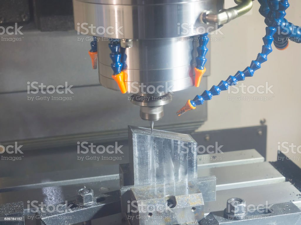 CNC machining center cutting mold stock photo