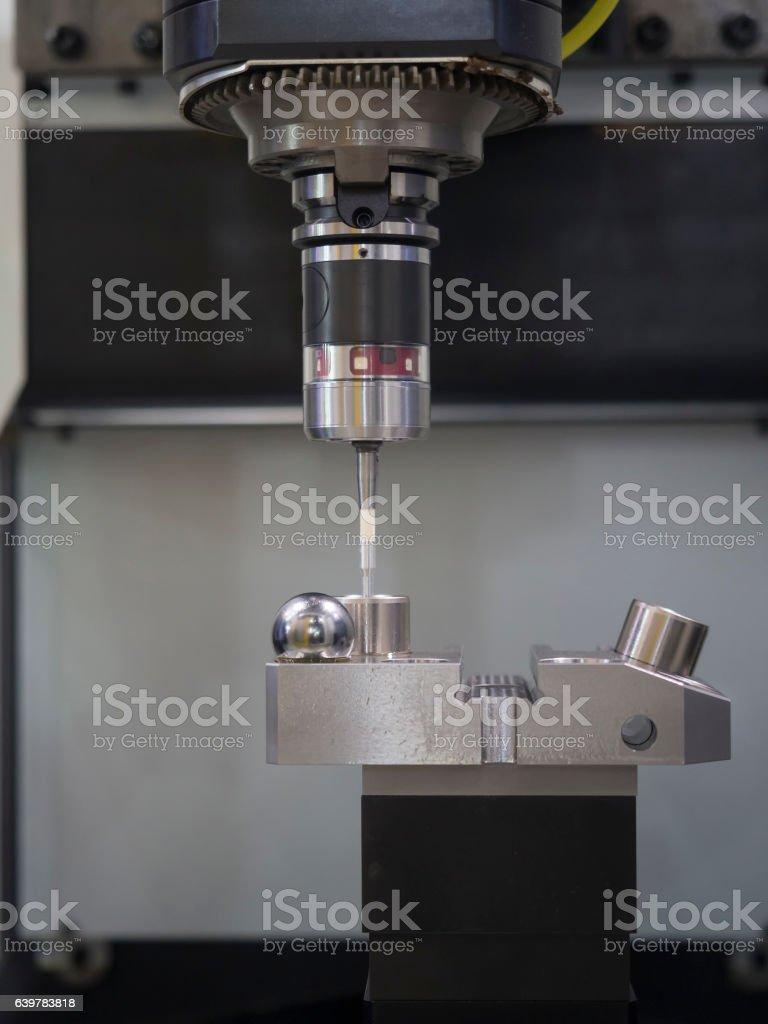 CNC machining center inspection dimension on machine stock photo