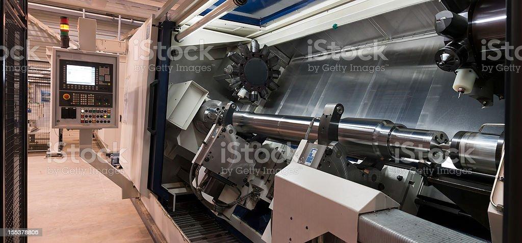 CNC machining tool.  Modern industrial lathe. stock photo