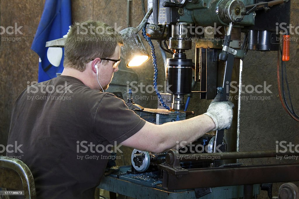 Machinist Taping Threads stock photo