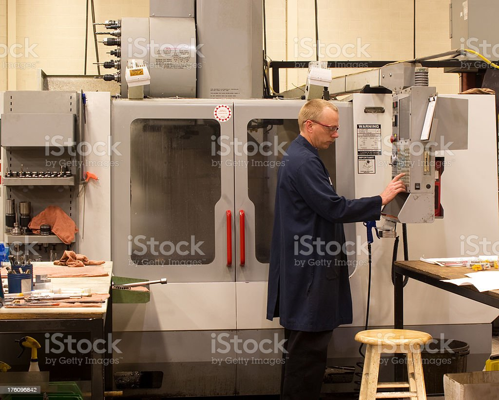 Machinist using a computer terminal stock photo