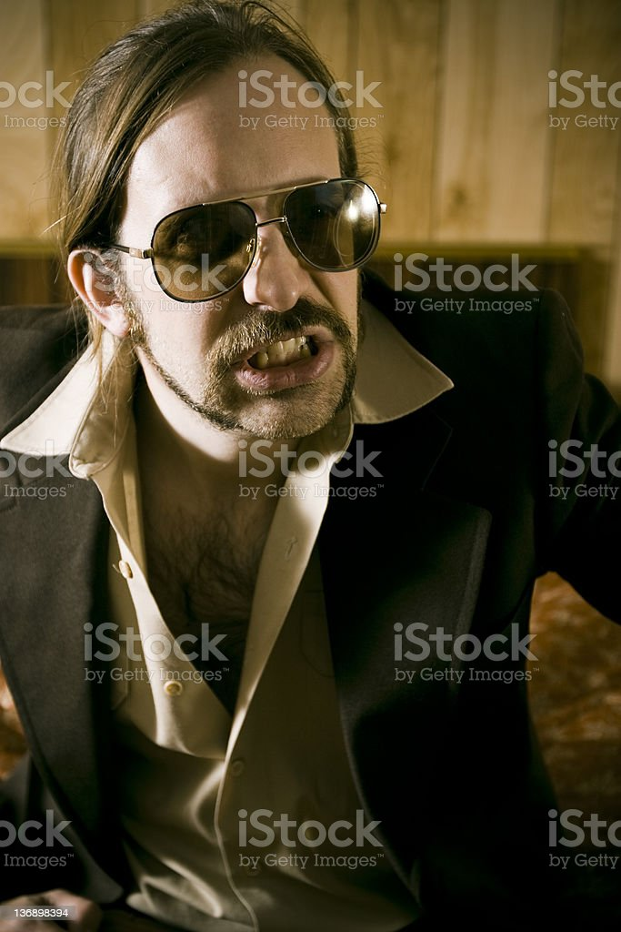 Macho in a cheap motel room... royalty-free stock photo