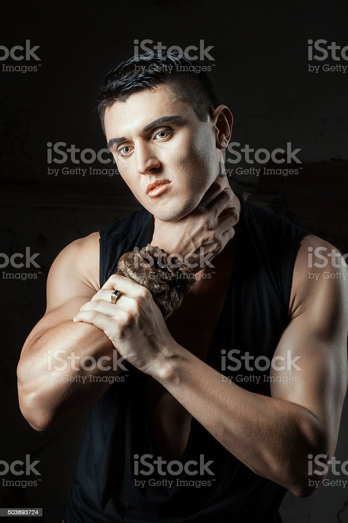 Macho man demonstrates self destructive behaviors. stock photo