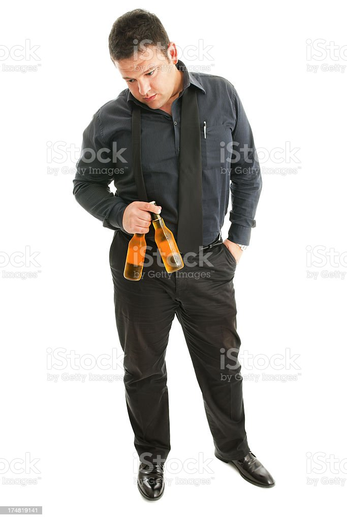 Macho man holding beer bottles royalty-free stock photo