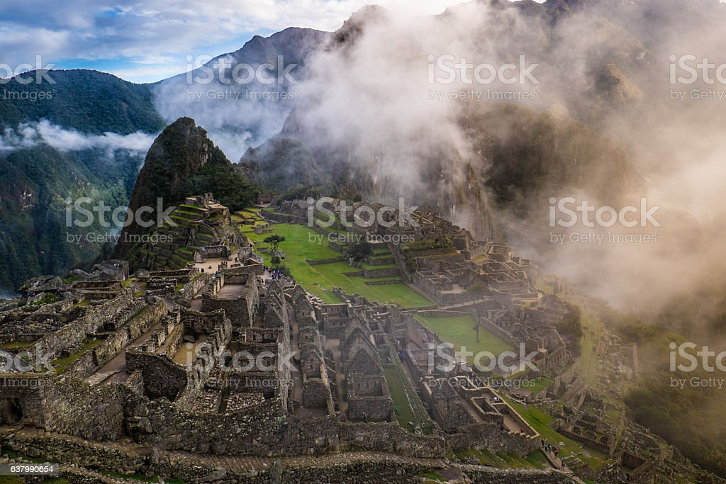 Machu Picchu at Sunrise and Clouds stock photo