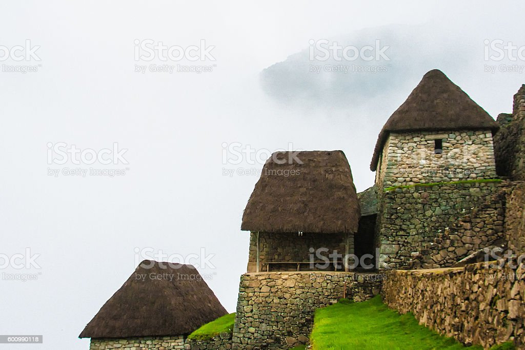 Machu Picchu, Peru: Green Inca Terraces, Stone Buildings, Fog stock photo