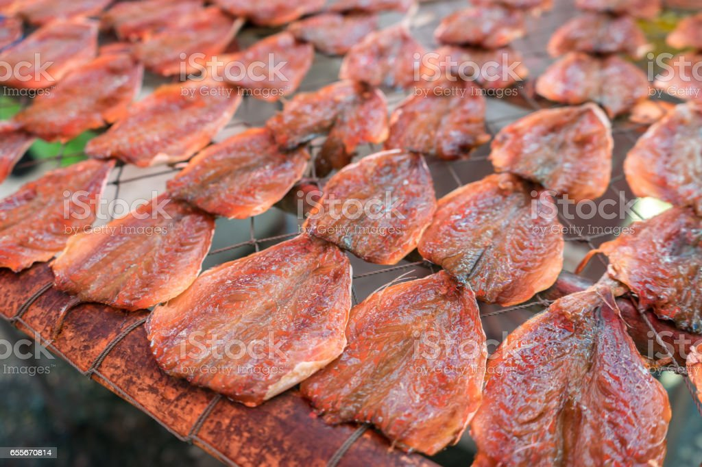 Mackerel meat and arranged under sun to preserve food stock photo