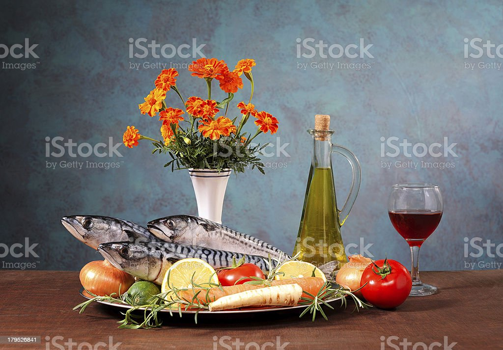 Mackerel, vegetables and flowers royalty-free stock photo