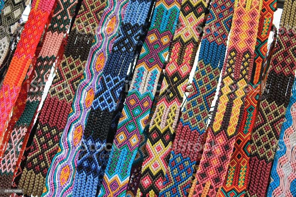 Macrame belts for sale at Mexican craft market stock photo