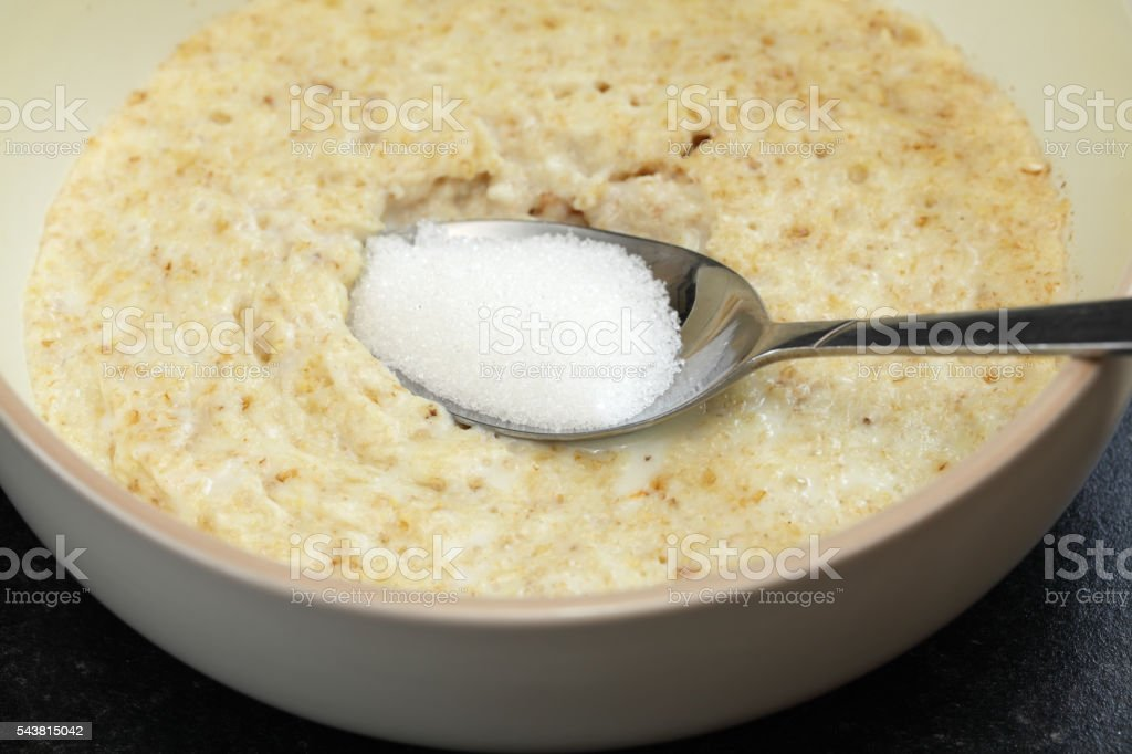 macro bowl of porridge and sugar stock photo