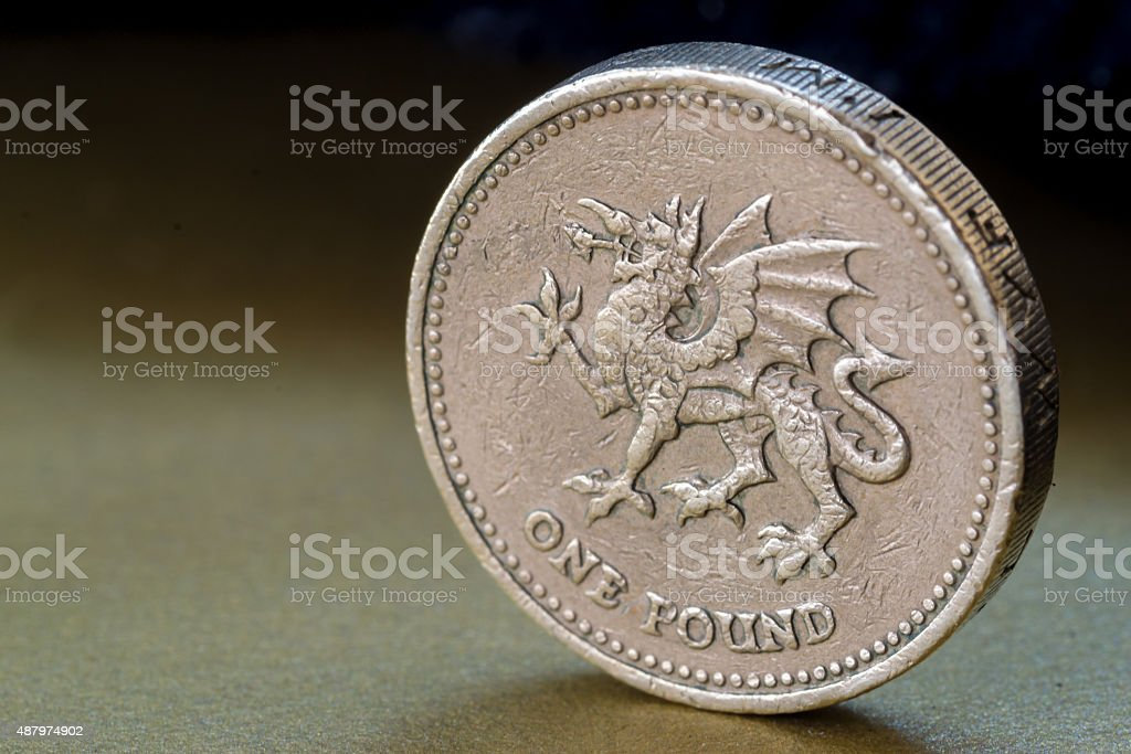 Macro Close Up of a Single British Pound Coin stock photo