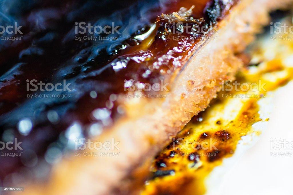 Macro closeup of Cooked Ribs stock photo