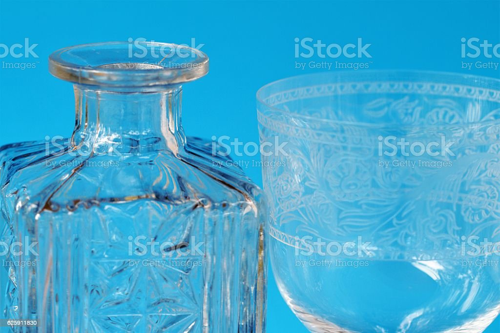 Macro closeup of crystal glass stemware with decorative etchings stock photo