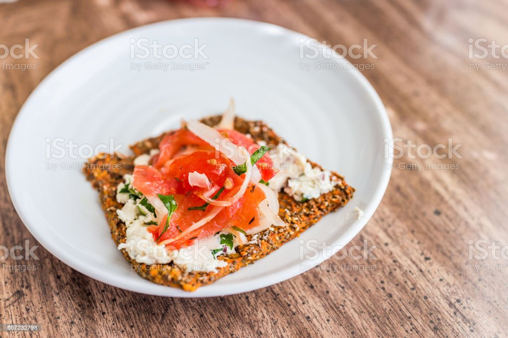 Macro closeup of healthy onion appetizer on chia flatbread toast and cheese stock photo