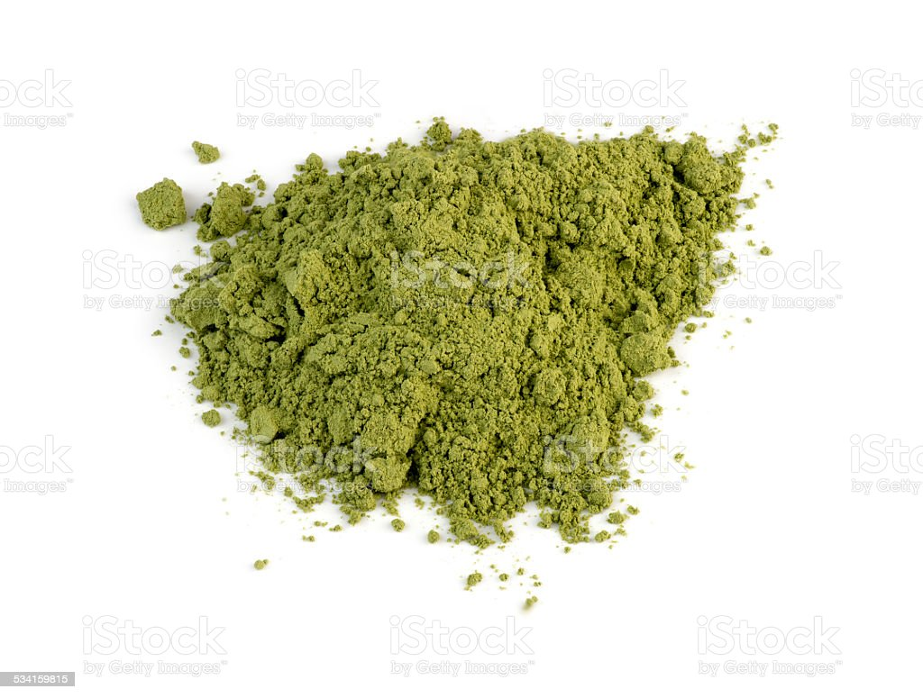 Macro closeup of organic wheatgrass powder isolated against whit stock photo