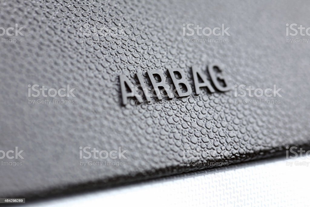 Macro close-up of text AIRBAG on car dashboard, shallow DOF royalty-free stock photo