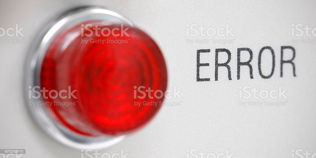 Macro close-up of text 'ERROR' on round red industrial light stock photo