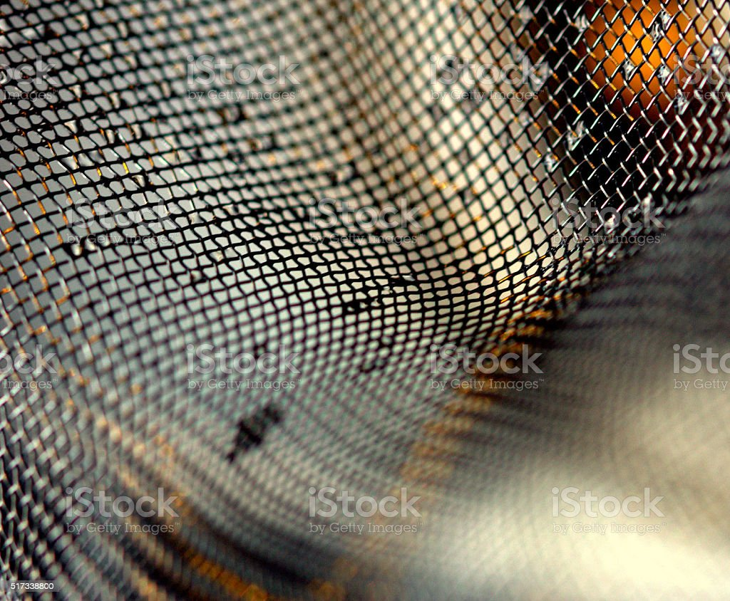 Macro close-up of wire mesh with water stock photo