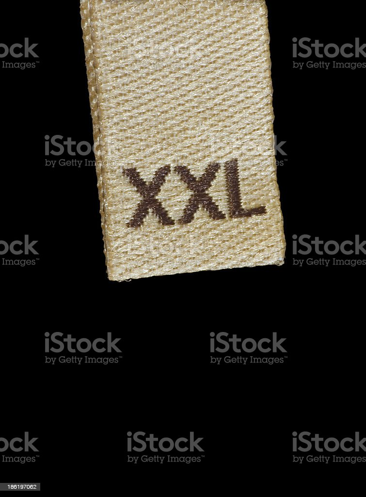 Macro closeup XXL size clothing label tag, isolated on black stock photo