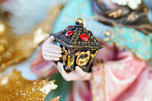 Macro detail of Magi gift in Christmas nativity scene